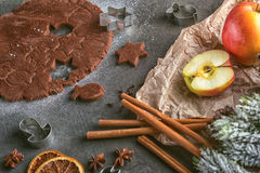 Cutting gingerbread cookie with christmas decorations and spice, christmas baking Stock Photos