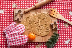 Cutting gingerbread cookie dough for Christmas Stock Photography