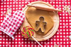 Cutting the gingerbread cookie dough for Christmas Royalty Free Stock Photography
