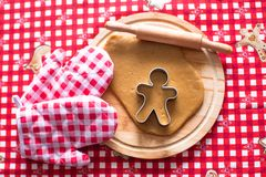 Cutting the gingerbread cookie dough for Christmas Royalty Free Stock Photo