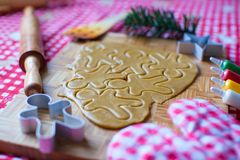 Cutting gingerbread cookie dough for Christmas Royalty Free Stock Image