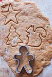 Cutting the gingerbread cookie dough for Christmas Stock Images