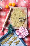 Cutting the gingerbread cookie dough for Christmas Royalty Free Stock Image