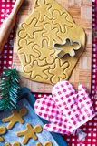 Cutting the gingerbread cookie dough for Christmas Stock Image