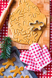 Cutting the gingerbread cookie dough for Christmas Royalty Free Stock Photos