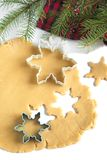 Cutting gingerbread cookies dough homemade for Christmas Royalty Free Stock Photography