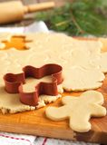 Cutting gingerbread cookies dough homemade for Christmas Stock Image