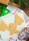 Cutting gingerbread cookies dough homemade for Christmas. Royalty Free Stock Images