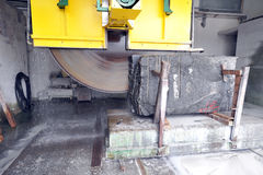 Cutting granite stone. Circular diamond blade saw cutting granite stone Royalty Free Stock Photo