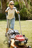 Cutting the Grass. Lawn mowing - a productive method for young teens to start earning some extra cash (also referred to as pocket money Stock Photography
