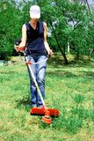 Cutting grass Stock Photography