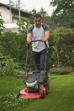 Cutting grass. Man at work by cutting grass Royalty Free Stock Photos