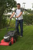 Cutting grass. Man at work by cutting grass Royalty Free Stock Images