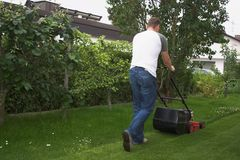 Cutting grass. Man at work by cutting grass Stock Image