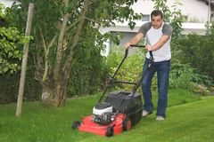 Cutting grass. Man at work by cutting grass Stock Photography