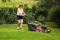 Cutting grass. Woman at work, cutting grass Royalty Free Stock Photo