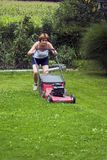Cutting grass. Woman at work, cutting grass Royalty Free Stock Images