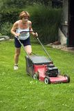 Cutting grass. Woman at work, cutting grass Royalty Free Stock Photography