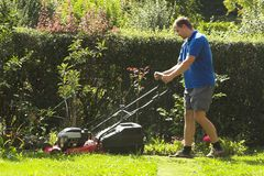 Cutting grass Stock Image