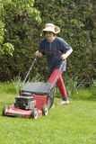 Cutting grass. There is a lot of work around the house in spring time Royalty Free Stock Photos