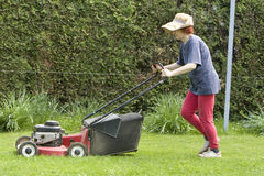 Cutting grass. There is a lot of work around the house in spring time Stock Images