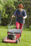 Cutting grass. There is a lot of work around the house in spring time Stock Photos