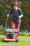 Cutting grass. There is a lot of work around the house in spring time Royalty Free Stock Photo