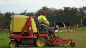 Cutting the grass. Workman on a industrial grass cutter Stock Photo
