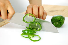 Cutting green pepper Royalty Free Stock Images