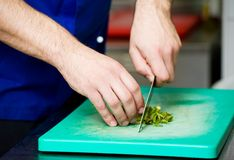 Cutting greens on board Royalty Free Stock Images