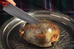 Cutting the haggis Royalty Free Stock Photography