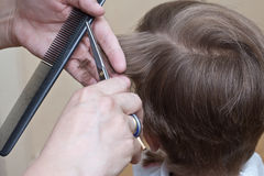 Cutting hair Stock Photos