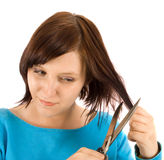 Cutting hair. On the white Royalty Free Stock Photography