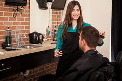 Cutting hair at a barber shop Stock Photos