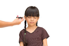 Cutting the hair of a little girl Stock Images