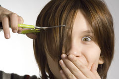 Cutting hairs. Girl cutting her hairs royalty free stock photos