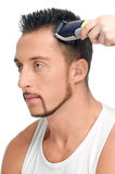 Cutting hairs of attractive man Stock Photography