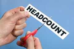 Cutting the headcount Stock Image