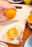 Cutting healthy fresh orange Stock Photos