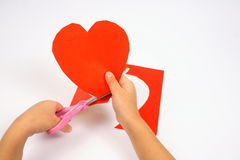 Cutting heart shape Royalty Free Stock Photography
