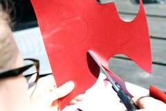 Cutting heart shape out of red paper Royalty Free Stock Photo