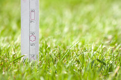 Cutting height. Meter that measures the height of mowing Stock Photos
