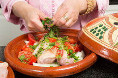 Cutting herbs in a tajine Royalty Free Stock Photography