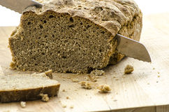 Cutting a homemade bread Royalty Free Stock Photography