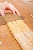 Cutting homemade egg pasta Stock Images