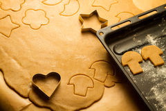 Cutting of homemade gingerbread cookies Royalty Free Stock Photos