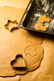 Cutting of homemade gingerbread cookies stock image