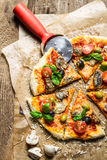 Cutting homemade pizza Stock Images