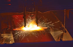 Cutting of the hot metal Stock Photography