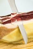 Cutting Iberian ham Stock Photos